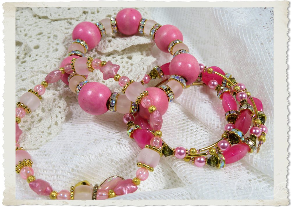 Pink bracelets with strass and dangles by Ingeborg van Zuiden