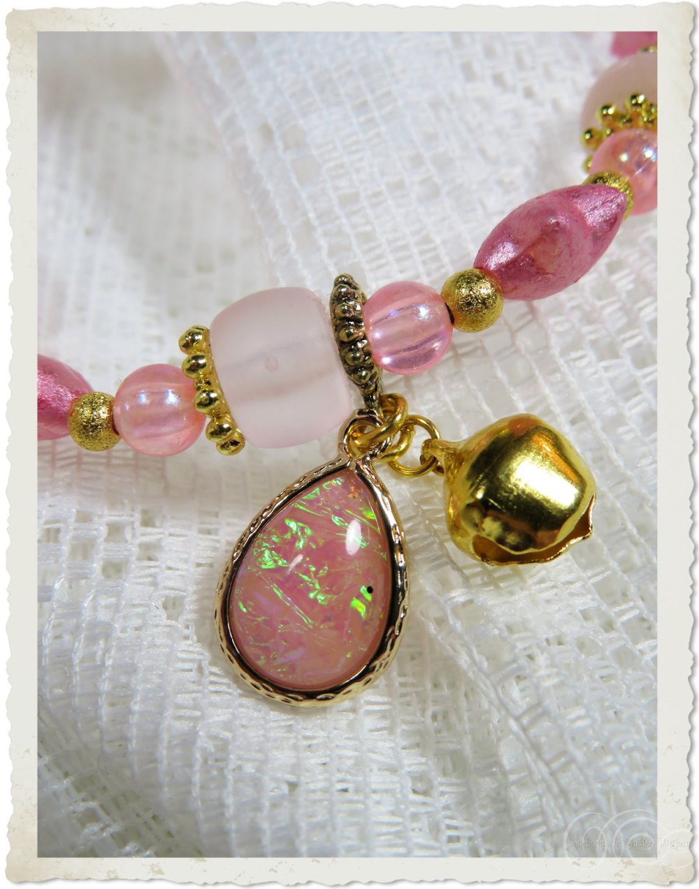 Opal iridescent gold hanger with bell