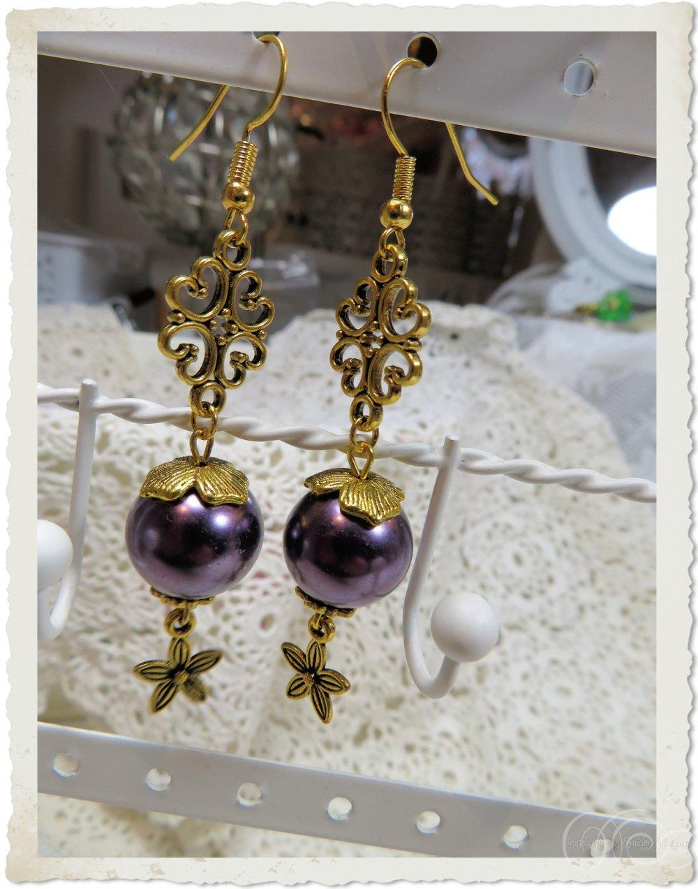 Dangling purple gold star earrings