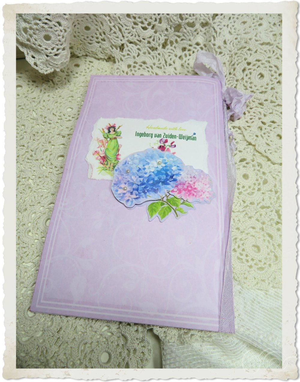 Backside of handmade card with ribbon and flowers