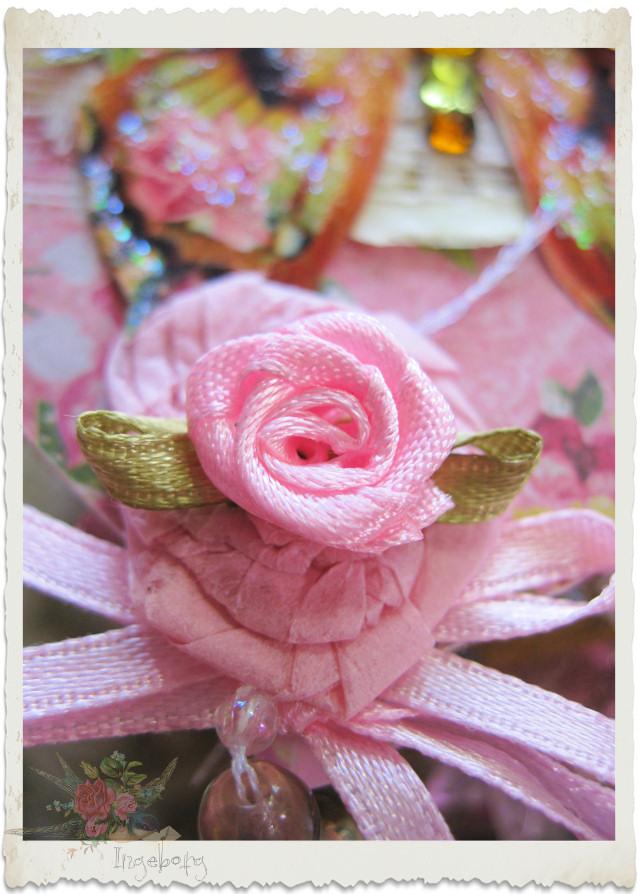 Ribbon rose on a paper rosette
