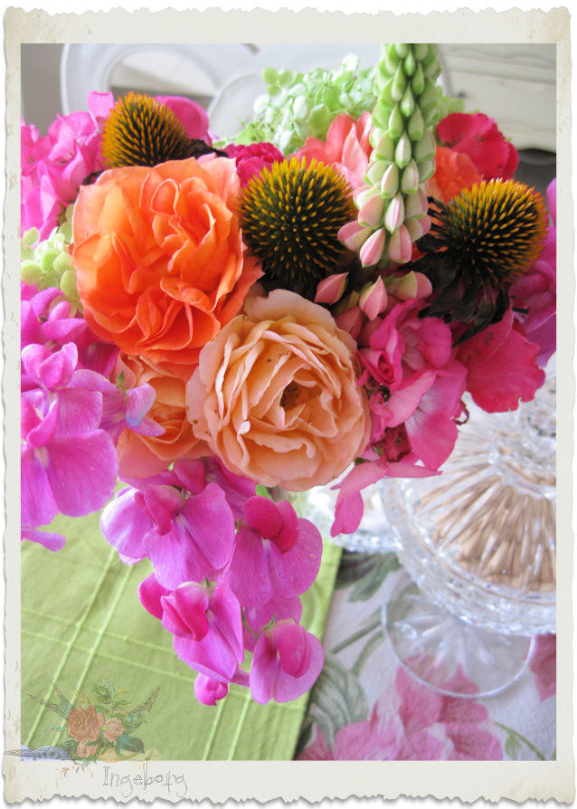 Orange peach roses lupine and sweet pea bouquet