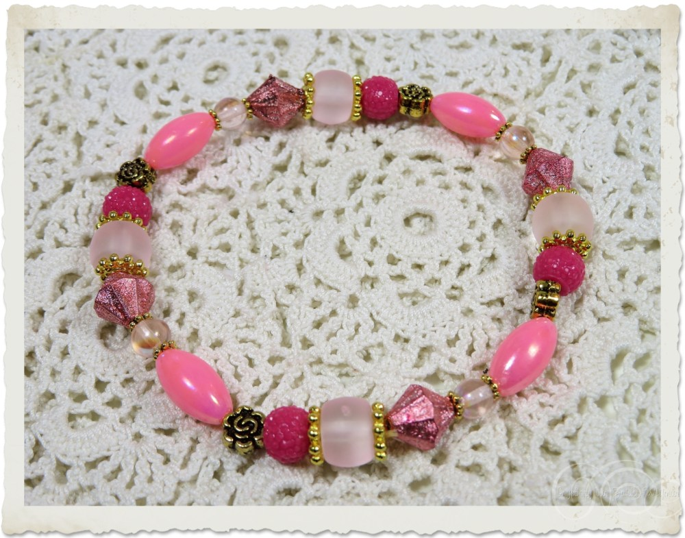 Pink bracelet with gold findings