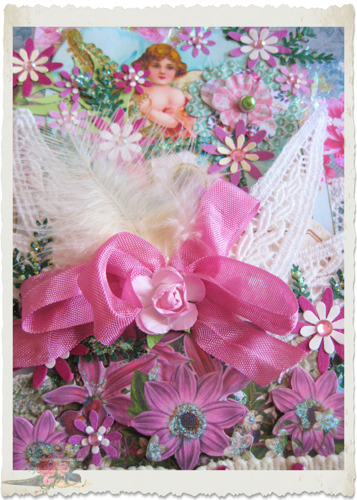 Details of pink ribbon with rose and feathers