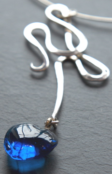 silver and blue stone scroll necklace