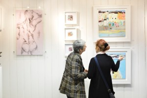 Visitors admiring work at the gallery