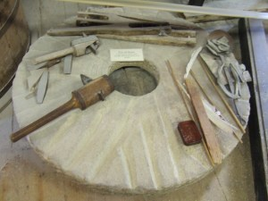 Millstone with tools to dress it when it had worn down too much.