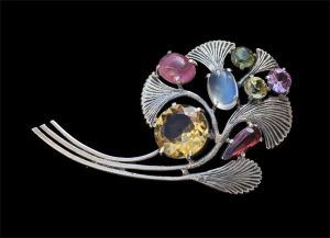 Brooch by Edith Linnell, with silver, tourmaline, citrine and moonstone. Sold by Tadema Gallery.