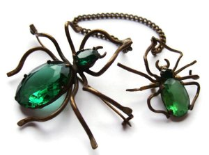 Two spider brooches joined by a safety chain. For sale in my Etsy shop.