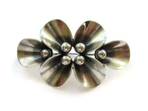 A different call leaf design brooch by NE From.