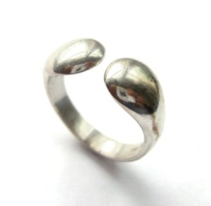 N E From sterling silver modernist ring.