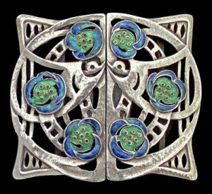Silver andenamel buckle, designed by Jessie M King for Liberty & Co.