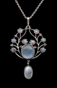 Jessie M King for Liberty & Co. Moonstone, enamel and silver pendant. Sold at Tadema Gallery.