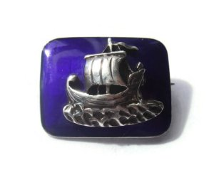 Tiny enamel and sterling silver Viking brooch. For sale in my Etsy shop: click on photos for details.