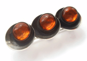 N E From Baltic amber moderist brooch. For sale in my Etsy shop: click on photo for details.