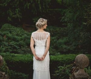 Can't resist it: I'm not a grily girl by any strecth of the imagination (I wear a dress about twice a year), but look at this gorgeous dress on a bride at the Larmer Tree Gardens.