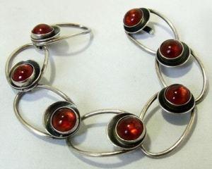 N E From amber bracelet.