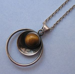 N E From tiger's eye pendant.