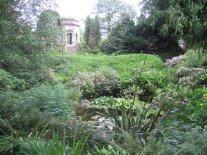 View of the Temple across the ornamental ponds at the Larmer Tree Gardens.