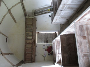The view from the pulpit, with the wormy rood-loft gallery, and the nails bent over on the inside of the door.