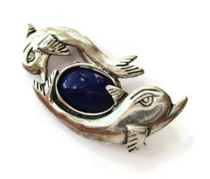Vintage sterling silver and blue glass dolphin brooch. For sale in my Etsy shop: click on photo for details.