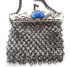 Vintage mesh metal purse with dragon design and blue cabochons.