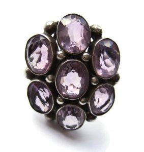 An amazing amethyst late Arts and Crafts ring, with seven magnificent amethysts.