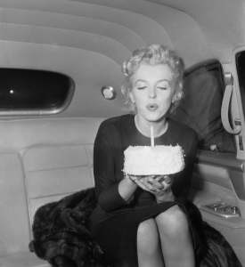marilyn monroe blowing out candle on cake