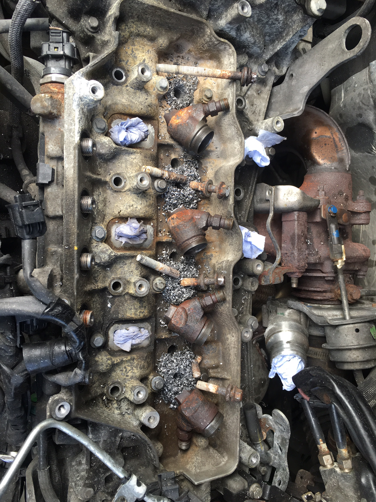 This could be described as a worst case scenario - all injectors broke from the top and injector bolts all requiring drilling. The vehicle is a Vaauxhall Vivaro 2011 2.0 cdti engine