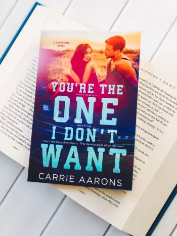 You're the One I Don't Want book on top of open book on table