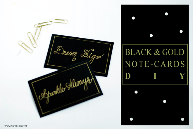 hand lettering done with gold paint pen on black paper