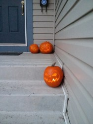 Carved pumpkins on a front porch, 2014