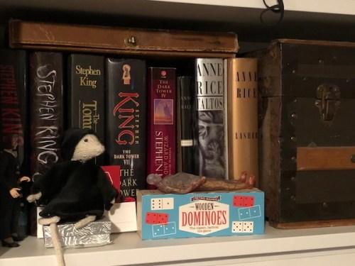 A shelf full of hardcover books