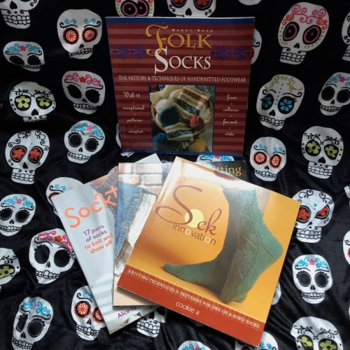 My autumn reads have a lot of fibre content. Pictured: A variety of knitting books specializing in hand-knit socks.