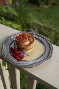 Apple Rose with custard and redcurrants