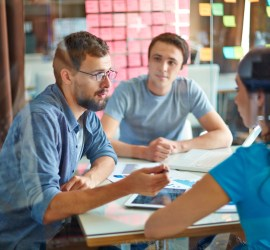 Innovate Communicate helps you communicate more clearly with your clients and your own team - image of two men and a woman sitting at a table talking