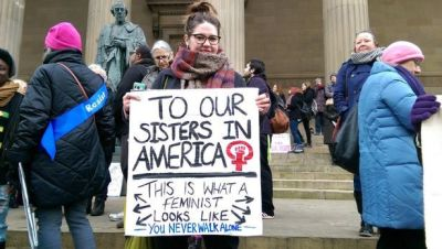 'To our sisters in America, this is what a feminist looks like. You never walk alone' banner