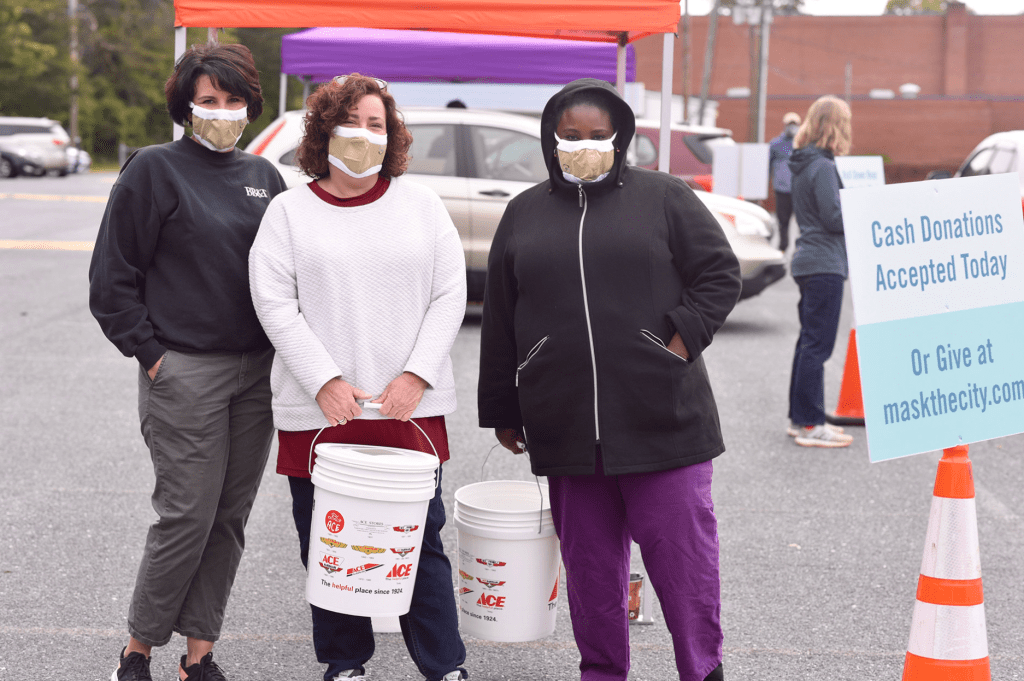 Women distributing masks at a Mask the City event in Winston-Salem, NC.