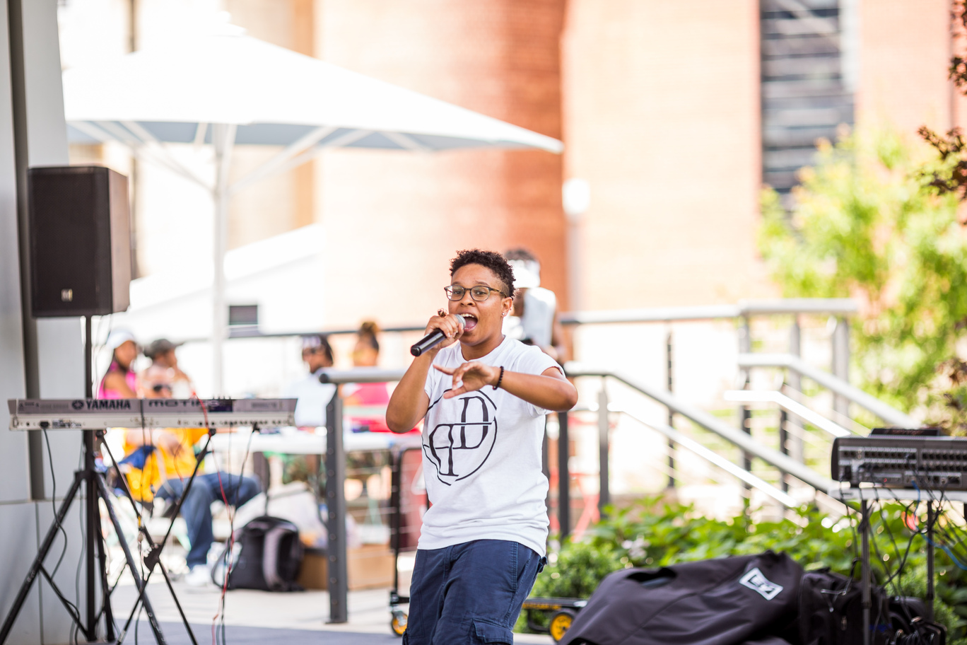Singer on stage at Bailey Park during Food Truck Friday.