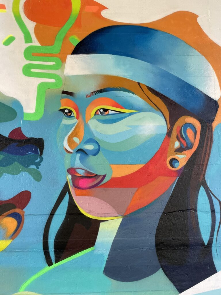 """Portrait of a woman on """"Aspire to Inspire"""" art mural."""