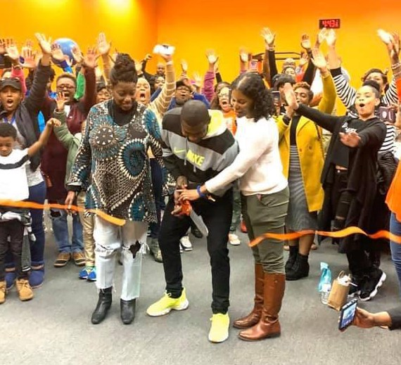 Small Business Center clients celebrate opening of business.