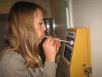 Someone using a breathalyzer