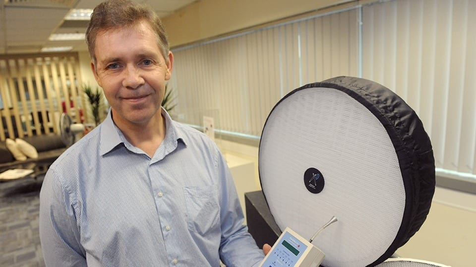 Prof Obbard, holding a particulate monitor, with the AiRazor filtration system
