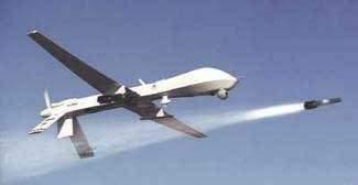 Armed Predator drone firing Hellfire missile (Photo credit: Wikipedia)