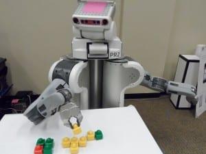U of Washington The UW's robot builds a turtle model.