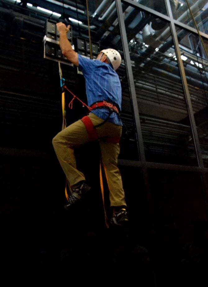 During testing, an operator climbed 25 feet vertically on a glass surface using no climbing equipment other than a pair of hand-held, gecko-inspired paddles. The climber wore, but did not require, the use of a safety belay. Image: DARPA