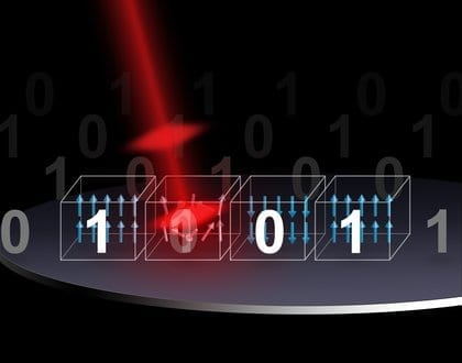 An artist impression of a laser pulse changing a magnetic bit