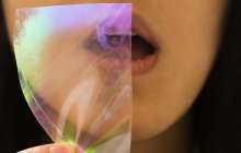 A breath reveals a hidden image in anti-counterfeit drug labels