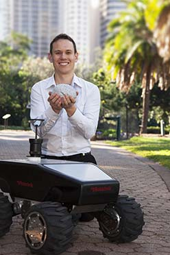 Dr Michael Milford with one of the all-terrain robots to benefit from brain-inspired modelling.