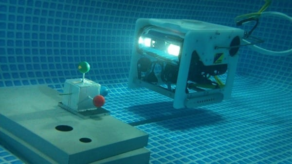 The MOS/AUV underwater robot approaching a target represented by coordinate system with three colored balls.